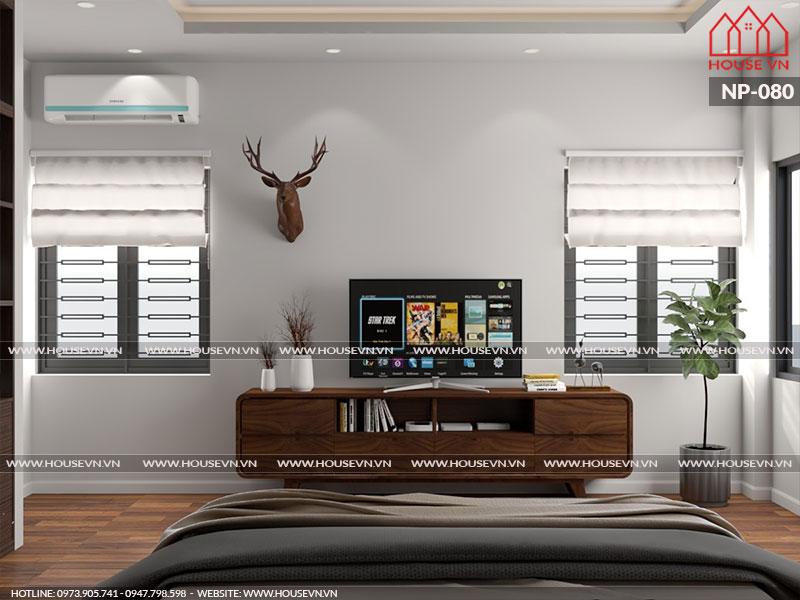Thiết kế nội thất phòng ngủ hiện đại tiện nghi với cách sắp xếp đồ đạc khá gọn gàng, ngăn nắp