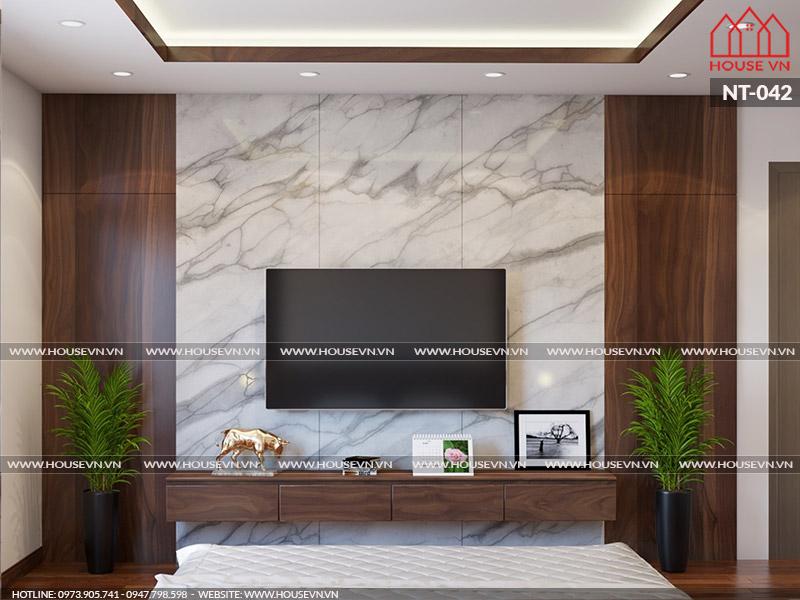 Vách ốp tường cùng tủ kệ tivi mang amfu sắc trầm ấm yêu thích của CĐT anh Dũng.