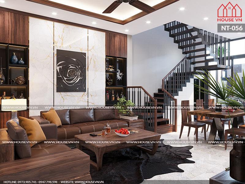 Lối liền với không gian phòng khách là sảnh thang và khu vực phòng bếp ăn