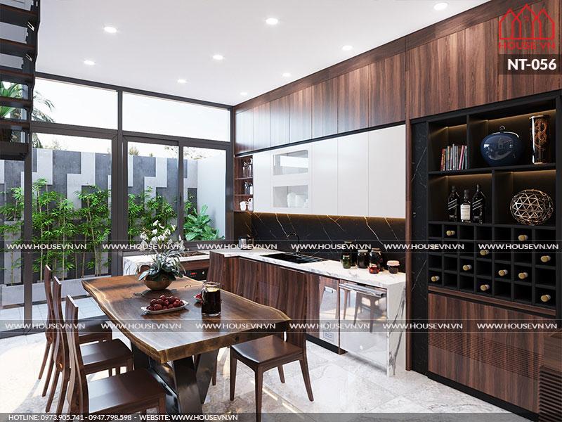 Lựa chọn tủ bếp chữ L cùng bàn ghế ăn nhỏ gọn là phương án khá lý tưởng dành cho không gian bếp ăn này