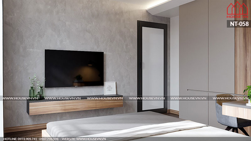 kệ tivi được thiết kế nhỏ gọn trong phòng ngủ.