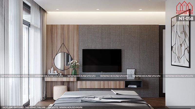Kệ ti vi và bàn trang điểm được đặt sát tường nhằm tiết kiệm không gian sinh hoạt trong phòng ngủ.
